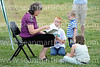 Bennett Librarian Kaye Barnes reads a story to Alexander MacDonald, Caleb Trout, and Amanda MacDonald