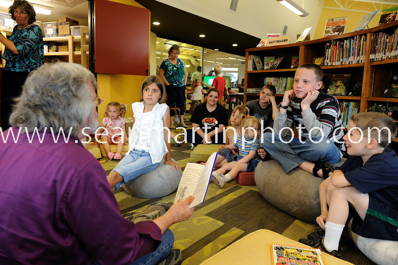Local Author reads his poems to a group of children.
