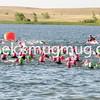 A heat (approximately 100 women) begin their swim