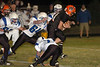 Tyler Laducer is tackled by Ben Wegener and Patrick Murphy