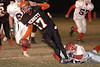 Kenny Weikel is tackled by Harrison Jackson