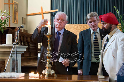 July 9th 2013 a Memorial service was held for Lee Rigby in St Mary Magdelene church ..  This picture shows councilor Fahy lighting a candle
