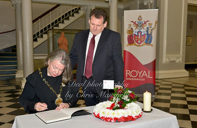Councillor Angela Cornforth, the new Mayor of Greenwich is first to sign the book of Condolence in Woolwich town hall.. Standing with her is the leader of Greenwich council Chris Roberts.