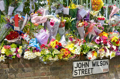 Floral tributes are being added continuously at the site of Lee Rigbys murder and also outside the main entrance of the Woolwich barracks .. May 25th 2013