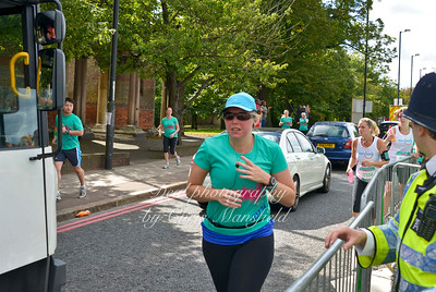 frustrated at the bottleneck, some runners take their chances in the traffic
