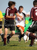 Kolby Whisler battles with Philip Readle for the ball