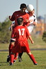 Kolby Whisler competes for a header with Oscar Borrego