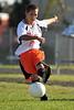 Daniel deLeon kicks the ball down the field