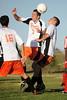 Brad Schneider heads the ball