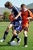 Travis Harrison steals the ball from Mac Decker