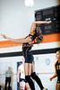 Aneiecia Lujan spikes the ball
