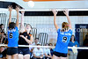 Kelsie Edmundson spikes the ball past Karli Salas and Sky Kopfman