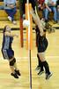 Krysta Villegas spikes, but misses the net.  Kelsie Edmondson and Jennifer Gaudin defend the net
