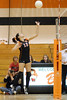 Jennifer Guadin prepares to tap the ball over the net
