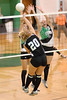 Badger Jessica Naylor spikes against BulldogsShasta L'heureux and Jamie Gaudin
