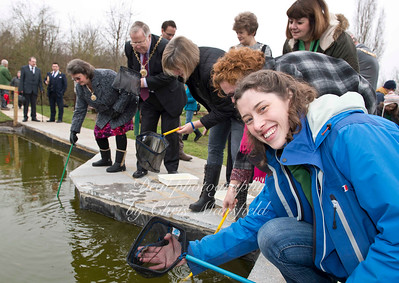 Woodlands farm education officer Hannah Forshaw catches a newt