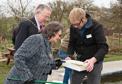 The Mayor and Mayoress of Greenwich check their catch at the dipping pond with farm manager David Jones