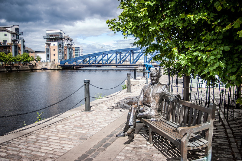 "The Shore, Leith, Scotland<br /> Sculpture by Lucy Poett : ""Sandy Irvine Robertson"", wine merchant. Behind is a harpoon gun from Port Leith Whaling Station, and the Victoria Swing Bridge : built in 1874."