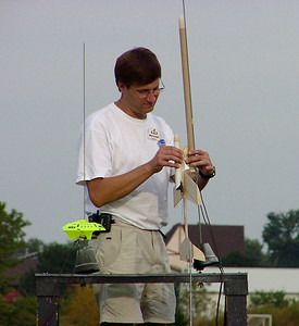 "Mark Joseph prepares his Edmonds Aerospace ""Arcie II"" radio-controlled boost glider for launch.  Photo by Greg Smith at the September 11, 2004 CIA launch."