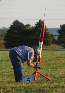 Chris Deem hooks up the igniter in his NCR Phantom 4000 at the September 25, 2004 CIA launch at Dodds Park.  Photo by Greg Smith.
