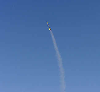 A rocket arcs into the wind during ascent.  From the September 25, 2004 CIA rocket launch at Dodds Park.  Photo by Greg Smith.