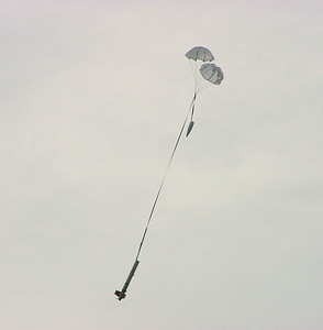 Jonathan Sivier's EZ-I 65 descends under two parachutes.  Photo by Greg Smith at the September 11, 2004 CIA launch.