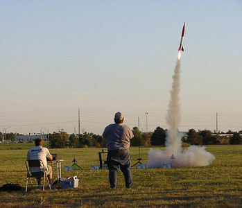 Chris Deem watches his Phantom 4000 lift off with an Aerotech G35-4 motor at the September 25, 2004 CIA launch.  Photo by Greg Smith.