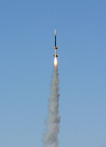 Greg Smith's Quantum Leap ascending on its H242 booster motor.  Photo by Greg Smith at the November 13, 2004 CIA launch near Flatville, Illinois.