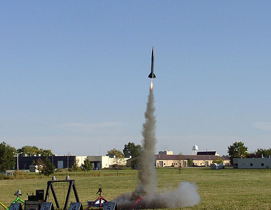 Chris Deem's scale Little John rocket lifts off at the September 25, 2004 launch at Dodds Park in Champaign, Illinois.  Photo by Greg Smith.