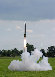 """Kevin Trueblood's """"Bad 2 the Bone"""" lifts off on an Aerotech H180 motor at the August 14, 2004 CIA launch.  Photo by Greg Smith."""