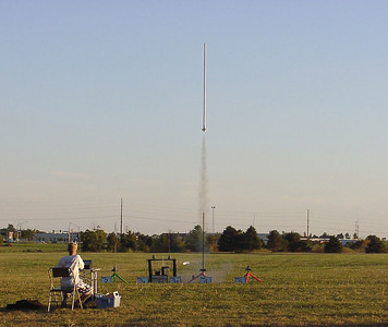 "Liftoff of Lon Westfall's ""Tall Boy"" at the September 25, 2004 CIA launch.  Adam Joseph is at the launch control panel.  Photo by Greg Smith."