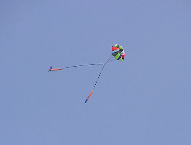 Recovery of Bill Mason's BSD 38 Special under a multi-colored parachute.  Photo by Greg Smith.