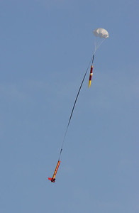 Mark's BSD 38 Special descends under parachute.  Note Octave Multipod video camera strapped on side of payload tube.  Photo by Greg Smith.