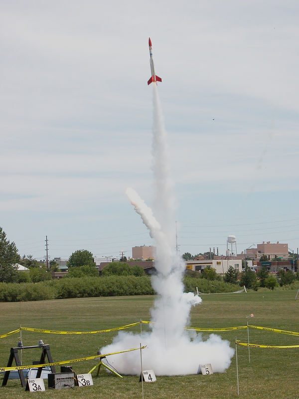 Chris Deem's BATFE Special heads for the sky.  Flaming propellant from one of the two exploded motors heads for the Olympic Monument.  Photo by Robert Brunner.