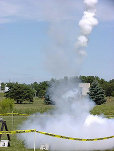 Liftoff of Chris Deem's BATFE Special with a cluster of four D11 and four E9 motors.  Two of the D11s failed at ignition, damaging the rocket, but it recovered and made a safe, stable flight.  This is image 16 of a series of 16 taken at 15 frames per second.  Photo by Greg Smith.