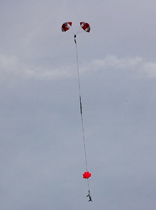 The booster section of Kevin Trueblood's upscale Estes Orbital Transport returns to Earth after releasing its radio-controlled parasite glider.  Photo by Alan Carroll.