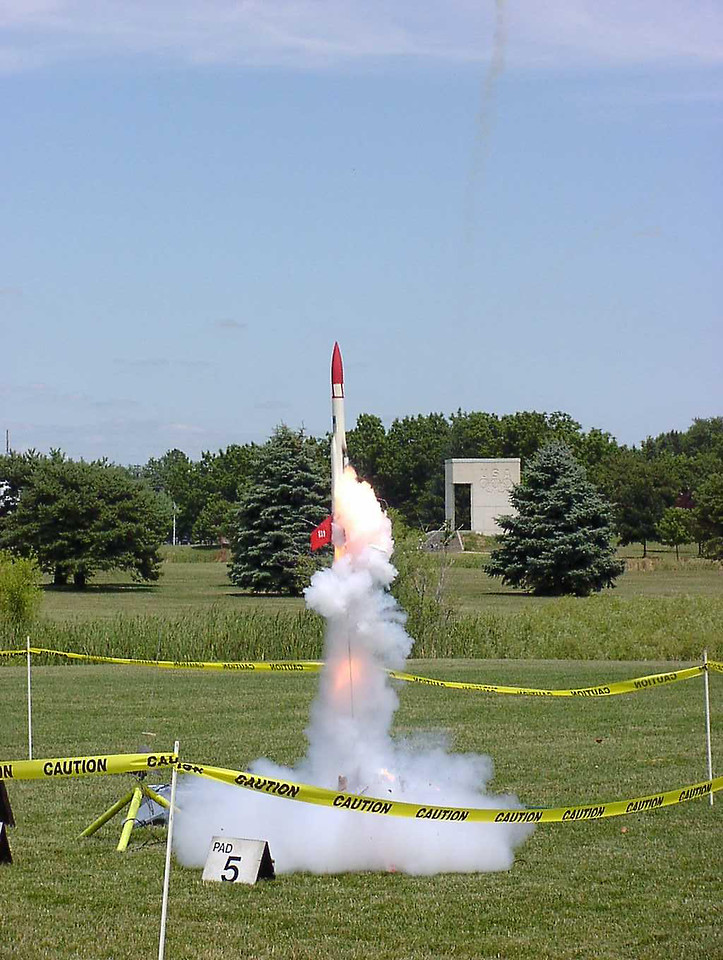 Liftoff of Chris Deem's BATFE Special with a cluster of four D11 and four E9 motors.  Two of the D11s failed at ignition, damaging the rocket, but it recovered and made a safe, stable flight.  This is image 6 of a series of 16 taken at 15 frames per second.  Photo by Greg Smith.