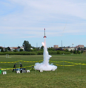 Chris Deem's BATFE Special outraces a chunk of burning propellant ejected from a failed motor as it goes on to make a successful flight.  Photo by Jonathan Sivier.