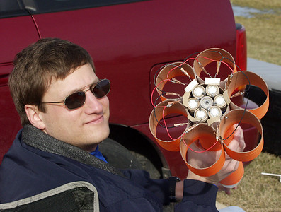 Mark Joseph shows off the interchangeable motor mount in his Cheap Dumb Rocket, almost ready for a launch with a cluster of seven D motors (one igniter still needs to be installed in the central motor).  Photo by Greg Smith at the February 12, 2005 CIA launch.