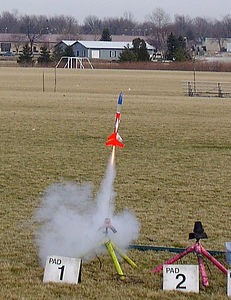 Greg Smith's modified Estes Loadstar launches with a D12 motor in the booster stage.  Photo by Greg Smith at the February 12, 2005 CIA launch.