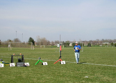 Jonathon Sivier moves out after tuning the video camera on in Greg Smith's smaller video rocket at the April 9,2005 launch. photo by Christopher Brian Deem