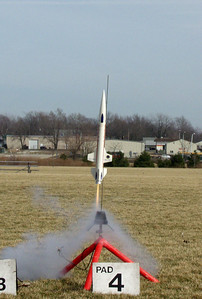 Greg Smith's DynaStar Orion lifts off with an E9-4 motor at the February 12, 2005 CIA launch.  This flight was successful, but the rocket proved unstable on two later launches.  Photo by Greg Smith.