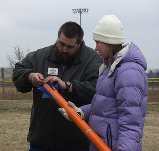 Members of the Synton amateur radio club at the University of Illinois flew a video transmitter payload as part of a project for the annual Engineering Open House event.  Nick Cassavaugh, a member of both the CIA and Synton, is shown prepping their rocket for one of its two successful G motor flights at the March 5, 2005 CIA launch.  Orange and blue are, of course, rhe U of I's school colors.  Photo by Greg Smith.