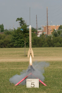 Nick Cassavaugh's uprated Super Big Bertha takes off with an Aerotech F20-7 motor.  Photo by Greg Smith