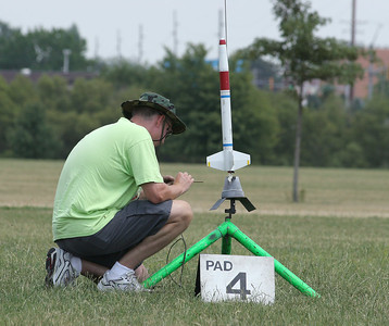 Robert Brunner preps his modified Estes Python for launch.  Photo by Greg Smith