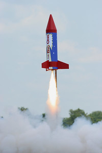 """Liftoff of Kevin Trueblood's """"The Big One"""" on an Aerotech H180 reload.  Photo by Greg Smith"""