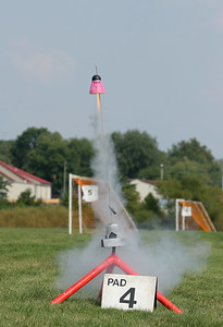 Jeff Deem's uprated Flying Fun Bird (with an ejecting motor mount featuring its own separate streamer for recovery) lifts off with a D12 motor.  Photo by Greg Smith