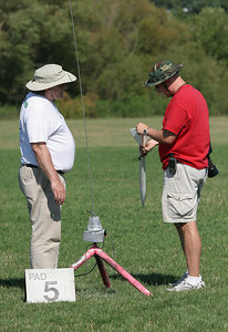 Robert had a hard time getting the F22 motor in his Airspike to ignite.  Here, he gets some advice from Lon Westfall.  Photo by Greg Smith