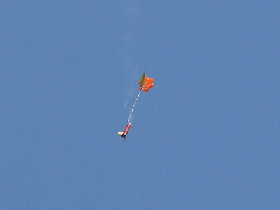 Just after ejection, Chris Deem's Primus I deploys its parachute.  Photo by Greg Smith