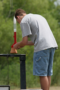 Benjamin Schaap hooks up the igniter leads on the Estes Loadstar kit he built back in February at a workshop for University High School students.  Although we had planned to fly the students' rockets the weekend after the class, weather had postponed every scheduled launch since then until June 24, when we finally had a nice day.  Ben was able to fly his rocket four times.  Photo by Greg Smith